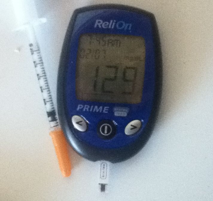 glucometer with a reading of 129