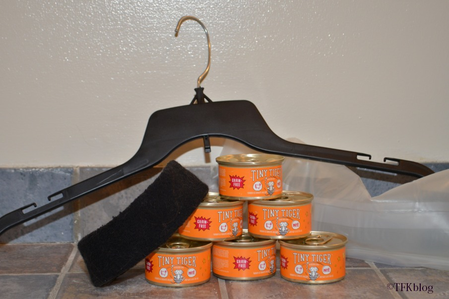 a twisty hook hanger, a sweat band and canned food