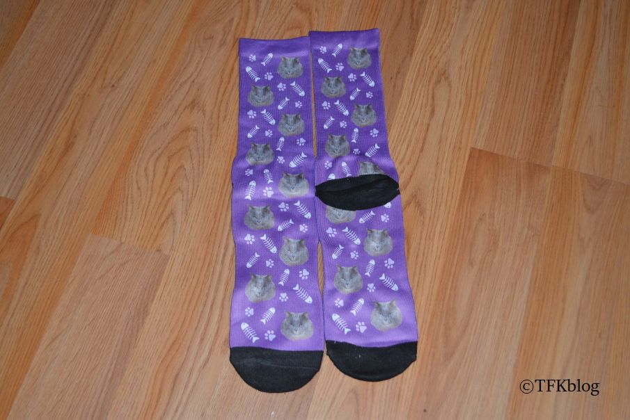 A pair of Socksery custom socks one face up the other face down