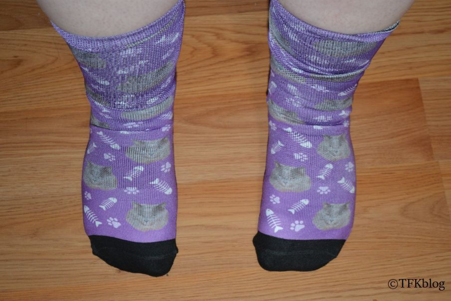 a photo of a pair of custom socks from Socksery being worn by a woman with size 9 wide feet